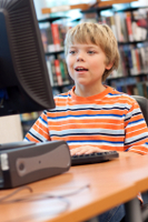 Boy at library computer