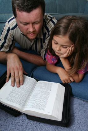 Father reading Bible